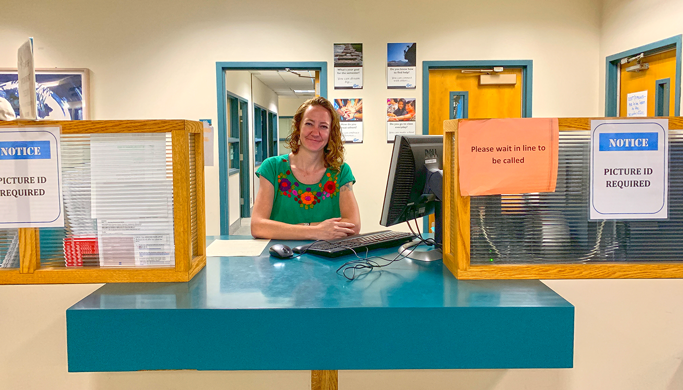 Santa Barbara City College's academic counselor Katie at the service desk.