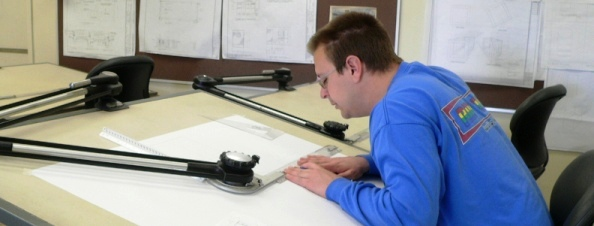 Student working at drafting table