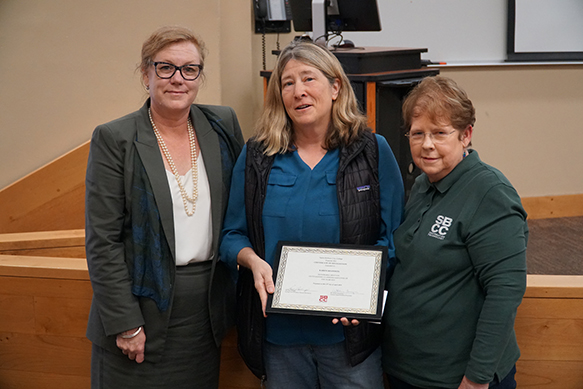 picture of Karen receiving honorable mention for oustanding classified member of year at April 2019 Board meeting