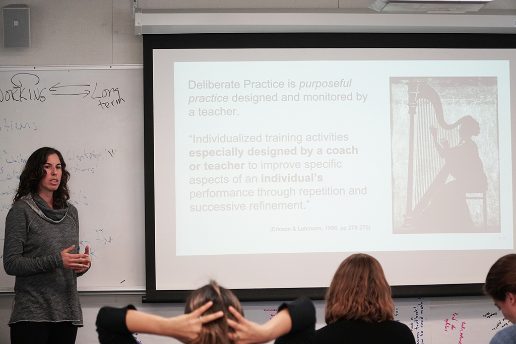 picture of Professor Jennifer Baxton, English Department, presenting to ALI workshop participants.