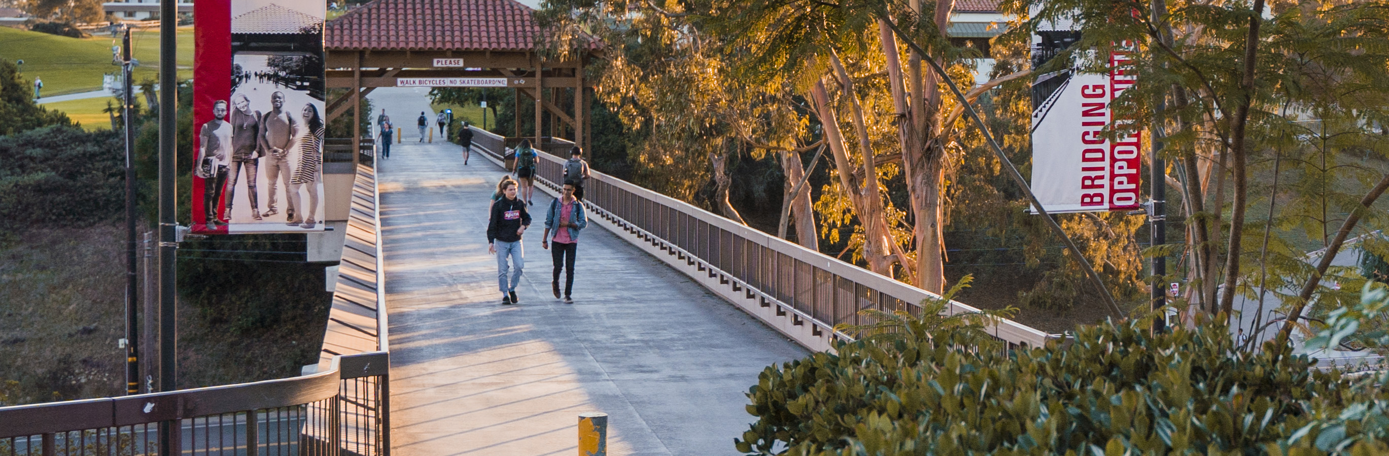 Santa Barbara City College students walking across the bridge.